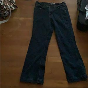 Dark wash at waist bootcut style jeans.
